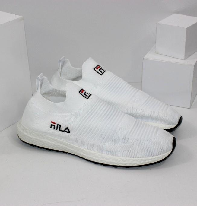 Легкі кросівки текстильні білі