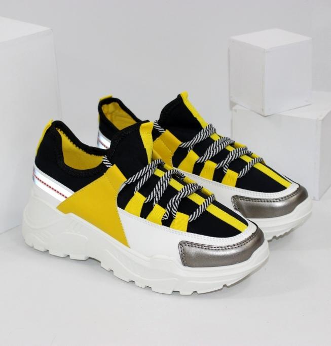 Стильні жовто чорні кросівки на білій підошві