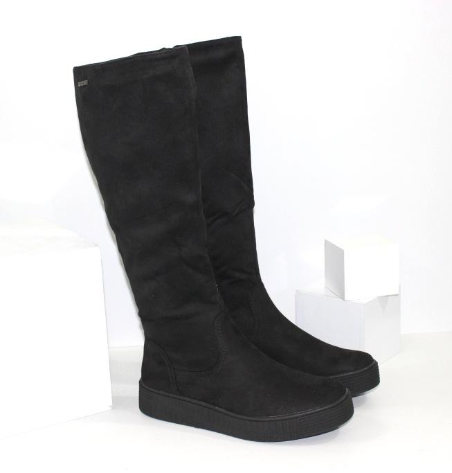 Модні чоботи 2021 на осінь і весну на товстій низькій підошві